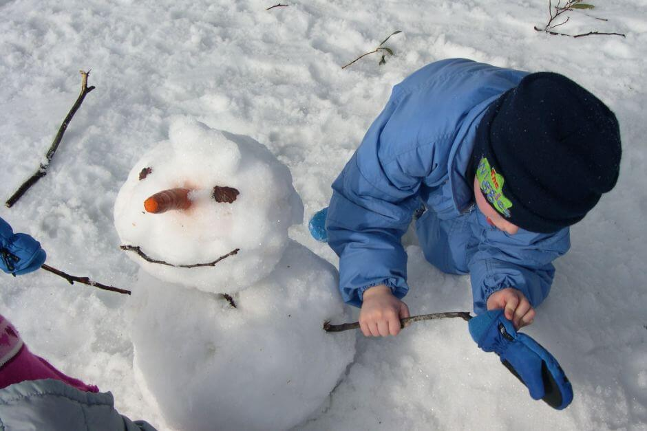 Kid and snow man